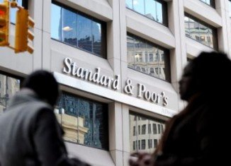 Standard & Poor's has cut Spain's credit rating and warned of risks to come