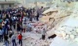 Syrian activists say at least 70 people have been killed in an attack on a house in Hama
