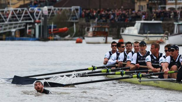 The 158th Oxford and Cambridge Boat Race on River Thames UK had to be halted midway through because of a swimmer photo