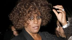Whitney Houston was buried with a diamond brooch and earrings next to the body of her father John Russell Houston Jr