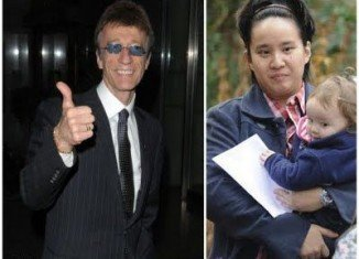 After 12 months of legal wrangling Robin Gibb's lover Claire Yang is said to have received the one off payment for three-year-old Snow Robin's care