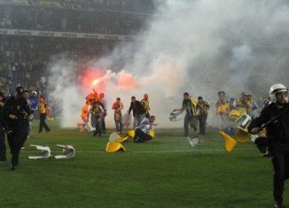 After the final whistle, Fenerbahce fans broke plastic chairs and threw them at the police and Galatasaray players