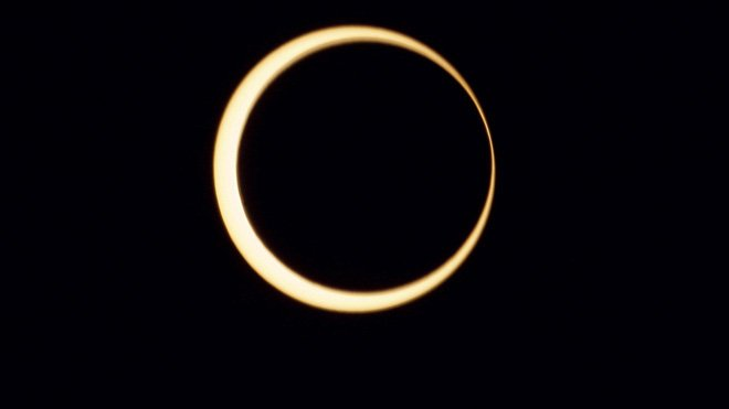 An annular eclipse has been viewed across a swathe of the Earth stretching across the Pacific from Asia to the western US photo