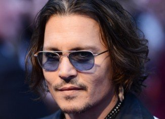 At the premiere of Dark Shadows in London Johnny Depp denied that his relationship with Vanessa Paradis is in trouble