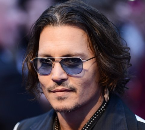At the premiere of Dark Shadows in London Johnny Depp denied that his relationship with Vanessa Paradis is in trouble photo