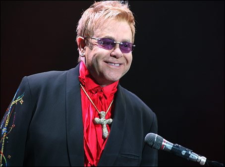 Elton John has been hospitalized with a serious respiratory infection photo
