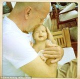 Emma Heming has posted an adorable photo on Twitter of Bruce Willis cuddling little Mabel Ray in his arms