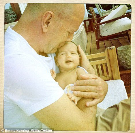 Emma Heming has posted an adorable photo on Twitter of Bruce Willis cuddling little Mabel Ray in his arms photo