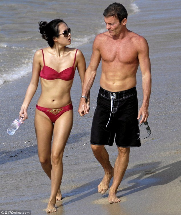 In this photo taken four years ago, Zhang Ziyi is seen holidaying with her former fiancé Aviv Vivi Nevo in St Barts