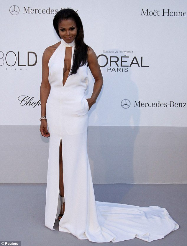 Janet Jackson arrived at amFAR's Cinema Against AIDS annual ball at Cannes in a stunning bright white Pucci by Peter Dundas gown that showed off her slim, toned frame