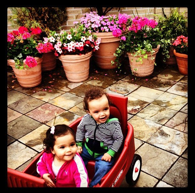 Mariah Carey's 13-month-old twins, Monroe and Moroccan, as they hitched a ride on a red wagon