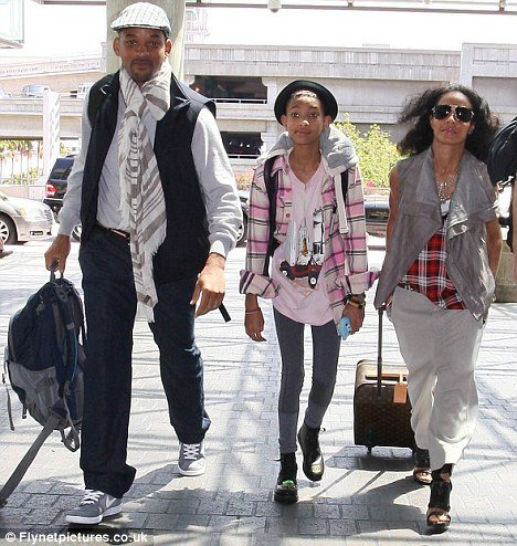 Mere days after laughing off reports that Will Smith and wife Jada Pinkett are splitting up, they made a show of family support by turning up at LAX together yesterday with daughter Willow in tow