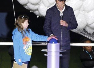 Niamh Clarke-Willis joined LOCOG head Lord Sebastian Coe to hit a button which launched balloons into the sky above London Olympic Stadium for this summer's Games