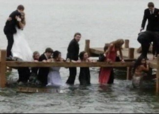 Prom night was almost a complete washout for a group of students from the Kettle Moraine High School, Wisconsin, when they posed for a picture standing on a pier and ended up in the water