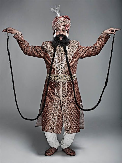Ram Singh Chauhan from India has the world's longest moustache, which is officially recorded by Guinness World Records as 4.29 m (14 ft) long