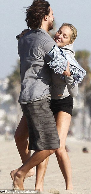 Sharon Stone was spotted getting more than a little frisky on the beach with her Argentinian boyfriend Martin Mica in Los Angeles