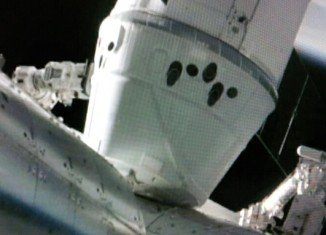 SpaceX unmanned Dragon cargo ship has been successfully attached to the International Space Station (ISS)