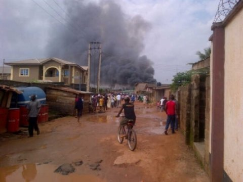 A Dana Air passenger plane with at least 162 people on board has crashed into a building in Nigeria's main city of Lagos