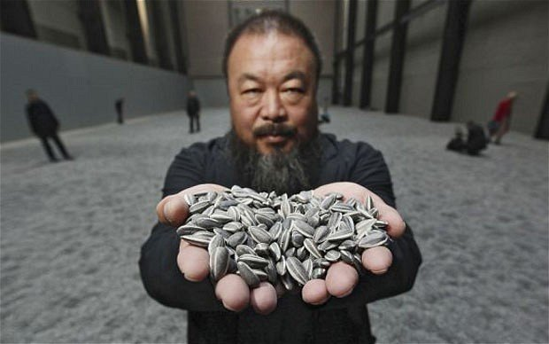 Ai Weiwei said that a number of police cars arrived at his studio and an employee filming the vehicles was roughed up photo