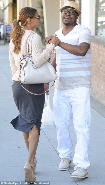 Bobby Brown seemed cheesed off as he left La Scala in Beverly Hills, with Alicia Etheridge trying to calm him down