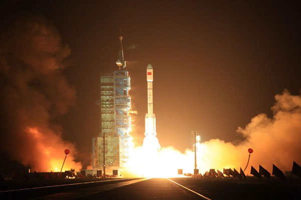 China announces it will carry out manned space flight Shenzhou 9 at some point in the middle of June photo
