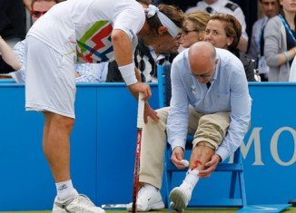 David Nalbandian was leading Marin Cilic at Queen's final when he kicked a panel in front of Andrew McDougall's seat