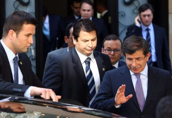 Foreign Minister Ahmet Davutoglu became the first senior Turkish official to challenge Syrias account of the downing of the jet photo