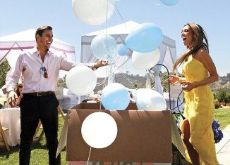 Giuliana and Bill Rancic used a creative way to let their friends know they were expecting a son at their guessing-themed Beverly Hills bash over the weekend