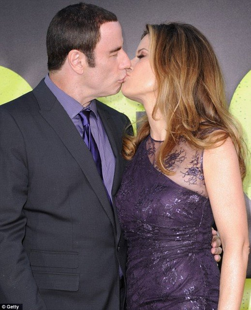 John Travolta was putting on a brave front with his wife Kelly Preston at the premiere of Savages in Los Angeles last night
