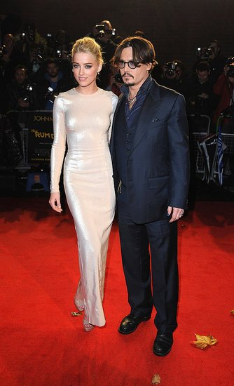 "Johnny Depp and Amber Heard are said to be so close that she has been a ""regular visitor"" to the New Mexico set of The Lone Ranger where he is currently filming photo"