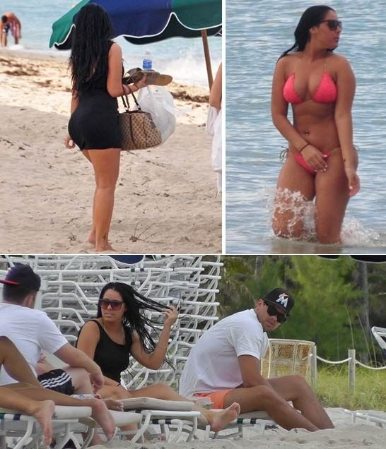 Kris Humphries has been spotted on a lounger in Miami Beach with his rumored new flame, a woman who had long black hair and an hour-glass figure