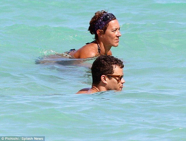 Kris Humphries was photographed in the turquoise blue Florida waters with the woman, who TMZ has identified as Tracy Paradise