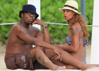 Newlyweds Bobby Brown and Alicia Etheridge were spotted hanging out on the beaches of Hawaii's Oahu island for their honeymoon yesterday