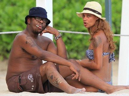 Newlyweds Bobby Brown and Alicia Etheridge were spotted hanging out on the beaches of Hawaiis Oahu island for their honeymoon yesterday photo