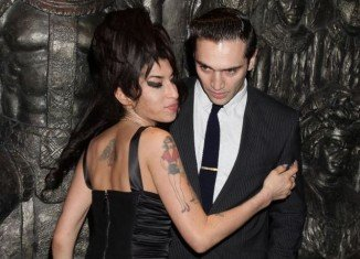 Reg Traviss, the former boyfriend of the late singer Amy Winehouse, has been charged with rape