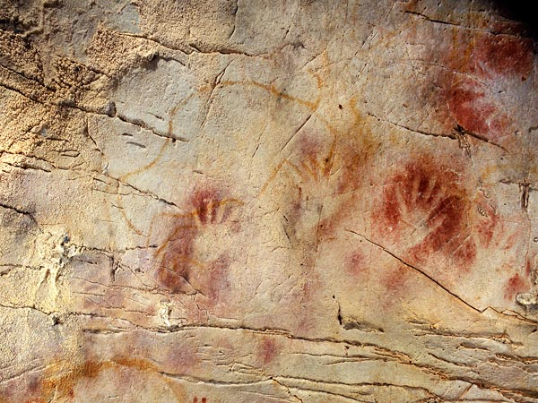 Researchers have found that red dots, hand stencils and animal figures represent the oldest examples yet found of cave art in Europe