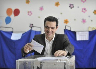 Right-wing New Democracy and left-wing Syriza parties are almost neck-and-neck after Greek parliamentary elections, according to the first exit polls