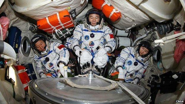 Thirty-three-year old Liu Yang flies with Commander Jing Haipeng, 46, and fellow flight engineer, Liu Wang, 42