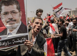 Thousands of people are gathering in Cairo's Tahrir Square to protest against a decision by the ruling military council to assume new powers