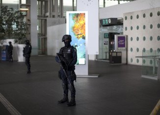 Three policemen have been killed in a shootout with two other officers at Mexico City's main airport
