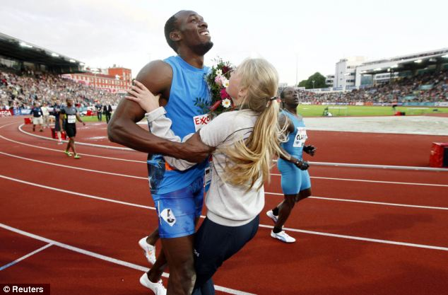 Usain Bolt crashed into a flower girl at the end of his 100 m sprint last night in Oslo where he ran the second fastest time this year
