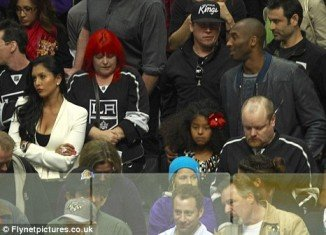 Vanessa and Kobe Bryant at a hockey game in Los Angeles on April 16