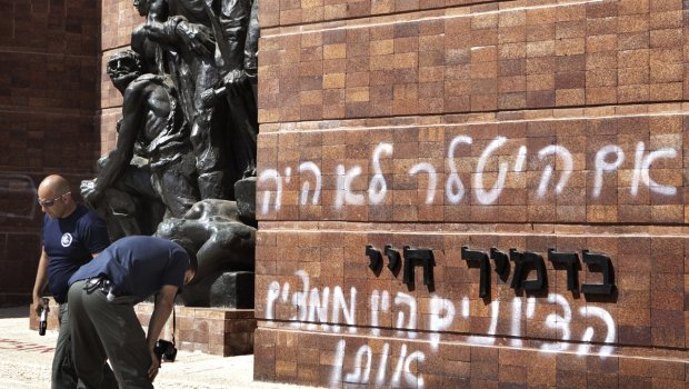 Yad Vashem Holocaust memorial in Jerusalem has been defaced with graffiti by vandals denouncing Zionism
