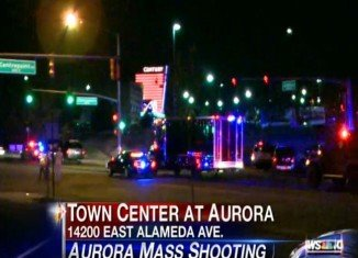 A gunman wearing a gas mask opened fire at the cinema complex in Aurora, at a midnight showing of The Dark Knight Rises