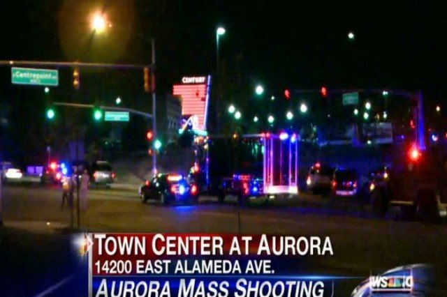 A gunman wearing a gas mask opened fire at the cinema complex in Aurora at a midnight showing of The Dark Knight Rises 640x426 photo