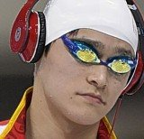 A number of Olympic swimmers at London Games are walking out to the pool wearing headphones