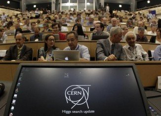 CERN scientists reporting at conferences in the UK and Geneva claim the discovery of a new particle consistent with the Higgs boson