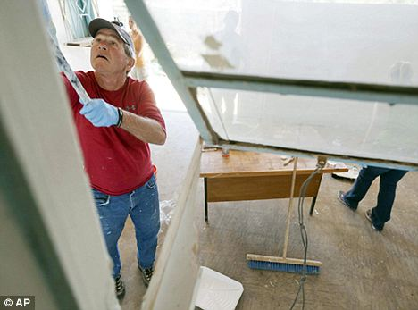George Bush during his mission to renovate a women's cancer screening center in Zambia
