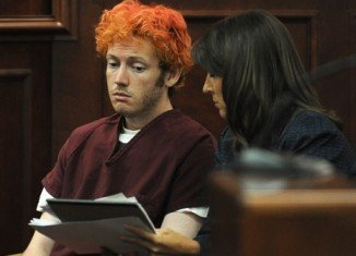 James Holmes sent a notebook describing a massacre to a psychiatrist at his university