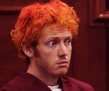 James Holmes, the suspect gunman at Aurora cinema, has been formally charged with 142 criminal counts in one of America's worst mass shootings